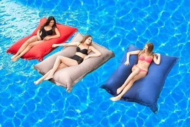 three floating pool bean bags with girls
