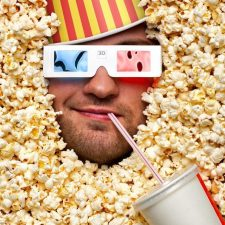 man drowning in popcorn